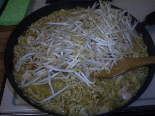Add an entire bag of bean sprouts to the pan.