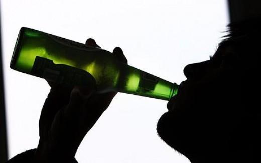 having a bottle of beer