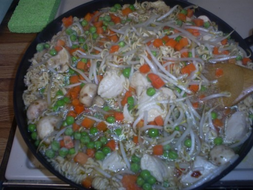Save money by making your own chicken stir fry dish with vegetables and Ramen noodles.