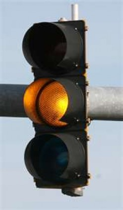 Do you slow down or pick up speed when the traffic light turns amber?