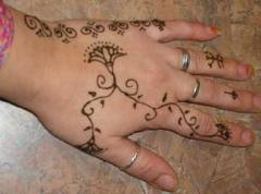 Awesome henna tattoo design for the hand.