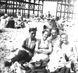 Blackpool beach with pier in background 1948. Mum, Dad, Aunt and Uncle.