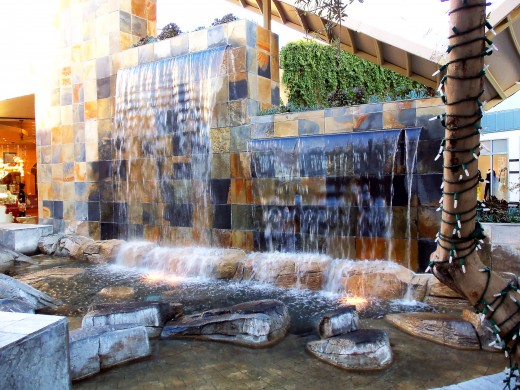 - A cascading miniature waterfall caresses the blue hued rocks below and stirs up a  refreshing gentle mist - Located at one of the rest areas within the GardenWalk -