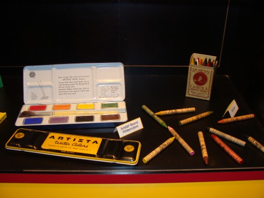 Examples of water colors and crayon boxes from years past.