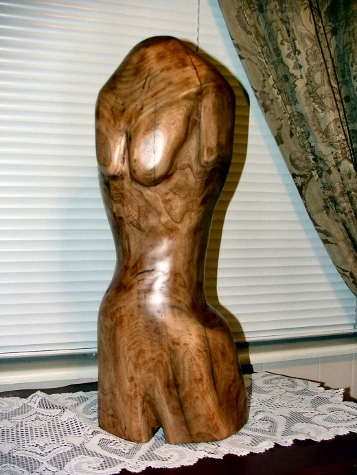 This woodcarving has been blocked in and is being allowed to stabilize prior to the final cut.
