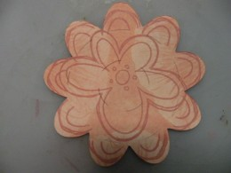 Stamping around the petal edges and larger flower stamp in the middle