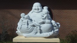 A statue of Buddha outside of a Buddhist temple.