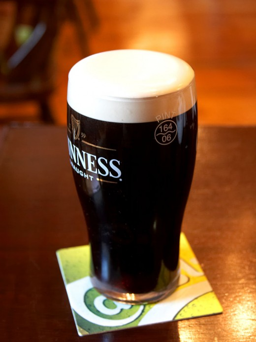 Guinness with its characteristic head.