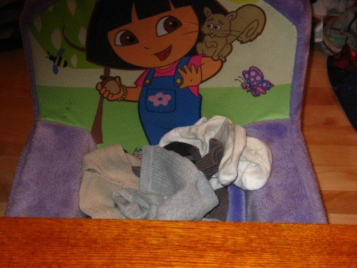 Dora keeps an eye on the socks