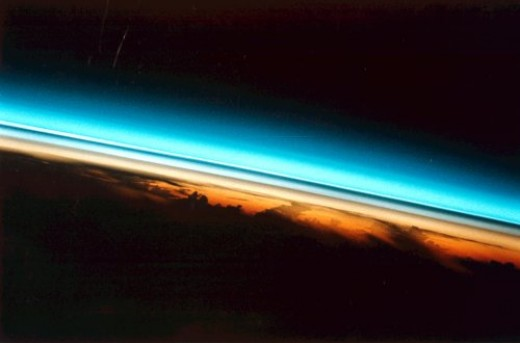 Earth's atmosphere: breathtaking!  But God's not there, it's just gas.