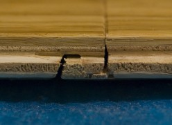 The short edge of the Bamboo Flooring is overlapped. As you may see from the picture, the precision milling holds the boards tightly together preventing gaps.