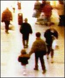James Bulger being led away. CCTV footage that helped convict Robert Thomson and Jon Venables