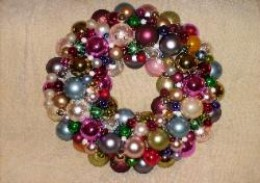 """Multi-colored ornaments adorn this wreath, which was about 26"""" in diameter."""
