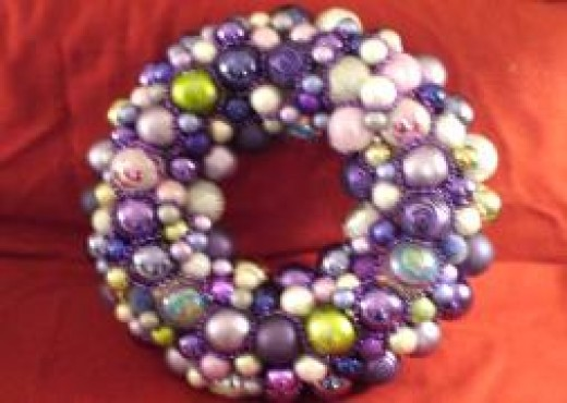 "This wreath had green and purple ornaments, and was made for a friend. It is about 26"" in diameter."