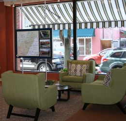 The Greenbrier Valley Visitors Center, located in downtown Lewisburg, has several seating area, a bank of computers, interactive displays, a wall of brochures, public restrooms & a help desk.