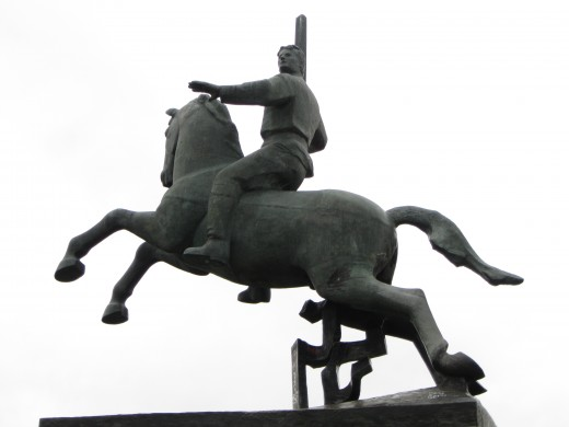 Mounted knight on large monument outside of South Wall of Kremlin in Veliky Novgorod, Russia.  Monument commemorates tenth century founding of Veliky Novgorod..
