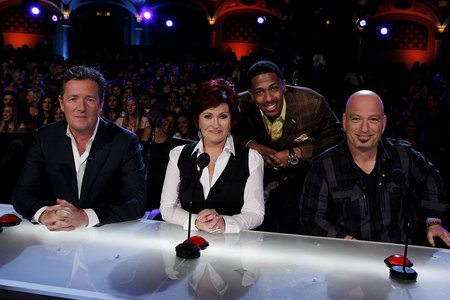 AGT judges Piers Morgan, Sharon Osborne and Howie Mandel pose with host Nick Canon