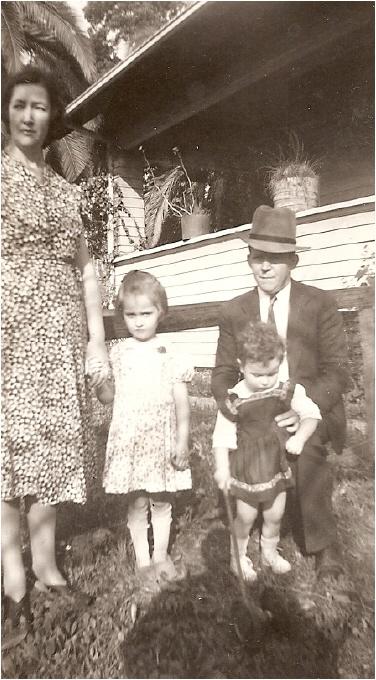 Flora, Christine Bill, holding his niece Nancy Herron,
