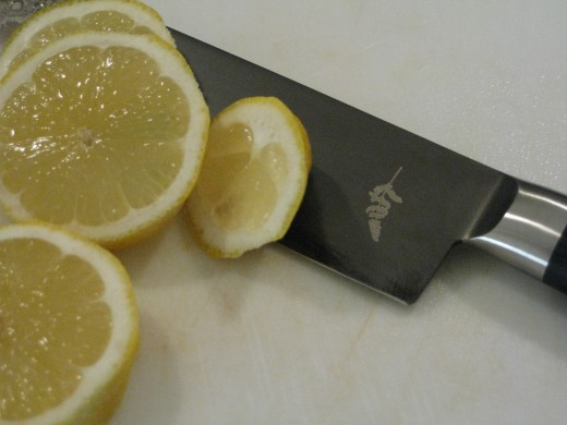 Reserve a couple of slices of fresh lemon to grill at the last minute