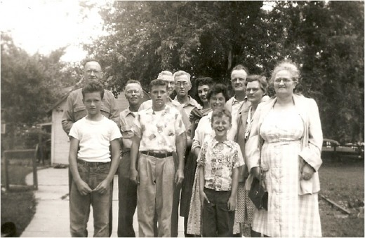 Back row: Andy Ronnie, Paul Herron, Estil Beets, Alec Herron, Marjorie (Beets) Evans, Bob Evans, minnie (Herron) Ronnie. Front row: Tommy Ronnie, Bob Evans Jr., Nancy Herron, David Herron, Mary (Herron) Beets