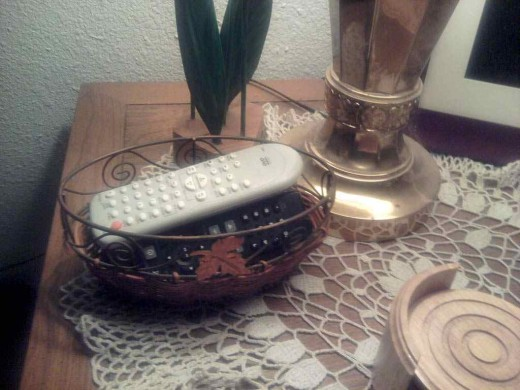A small basket is perfect for controlling those remotes!