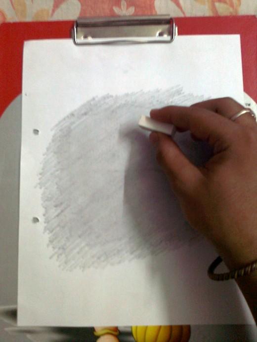 Using the eraser.