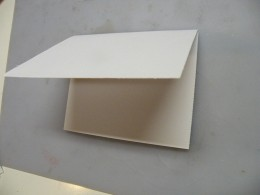 Fold the remaining back flap over the front bottom flap.