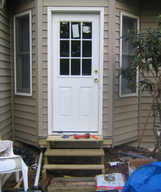 Fig 7.  Completed project.  The foot steps are temporary.  You can add a better walkway, porch or deck.