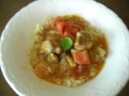 Finished Lamb stew over quinoa grain.