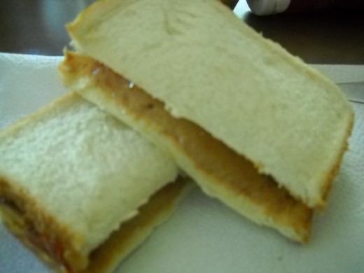 Peanut butter and strawberry jelly sandwich.