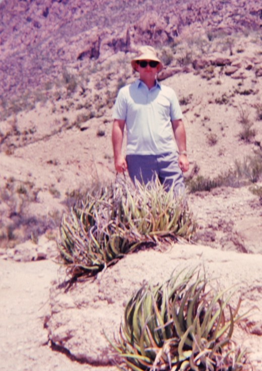 My hubby in Big Bend NP with desert plants.