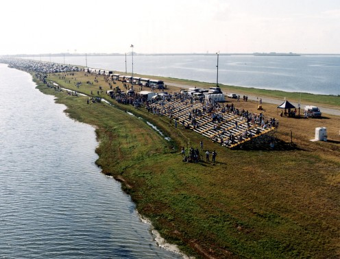 NASA employees, families and friends on the NASA Causeway over the Banana River near Kennedy Space Center. Launch of STS-26 and the Space Shuttle Discovery on September 29, 1988.
