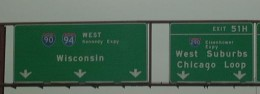 Checkpoint sign marking I-90 & I-94, which run concurrently in this location