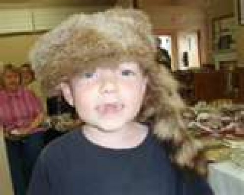 Just Like This Little Boy -- My Brother Wore His Davey Crockett Hat By Day and Slept in It By Night