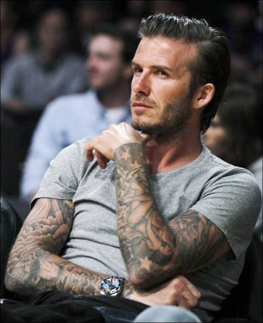 David Becham with tattoos in both hands