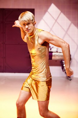 Sam in gold shorts on Rocky Horror Episode.