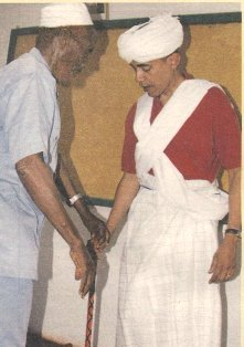 It is most fitting to see a criminal President in the Muslim Garb that he grew up with.