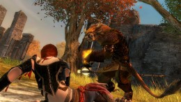A friendly Charr revives a downed elementalist