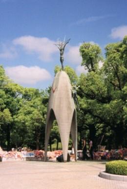 Sadako memorial surrounded by origami cranes