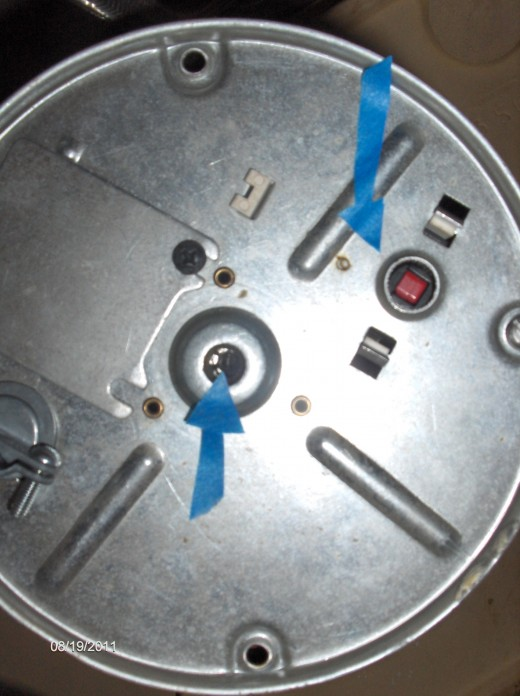 Middle arrow shows where to put key/Allen wrench. Left arrow shows reset button that you push when you have successfully turned the key and freed the clog.