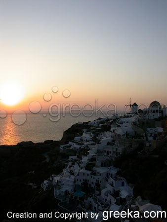 Santorini Photos : View of the village of Oia and the sunset on Santorini Greece.
