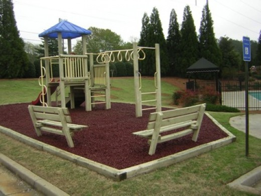 Rubber mulch for playgrounds and landscapes - Playground surfaces for home ...