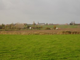 Village of Oost-Cappel, Nord, Nord-Pas de Calais, France. The small village and church, as seen from Roesbrugge-Haringe in Belgium.