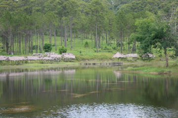 Cool mountain lake with picnic huts
