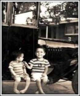 The author, left and older brother sitting on Uncle's 1921 Model T