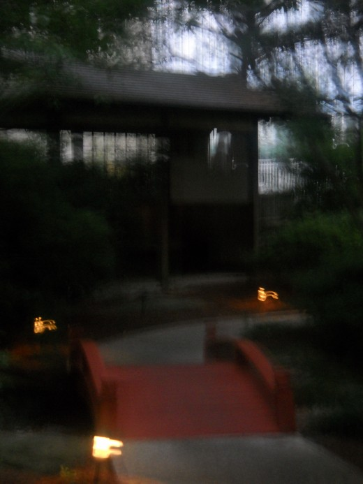 Lite path with bridge and seating area.