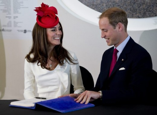The Duke and Duchess share a laugh after signing a guestbook at a citizenship ceremony