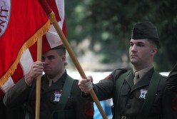 My son carrying the USMC flag in a parade in Rome, Italy.
