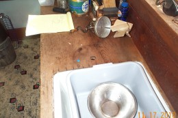 Here is the kitchen counter and sink as it was before we installed the pump. You can see the hole where a pump was removed, at the side of the sink.
