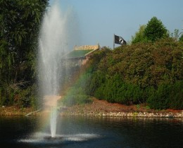 The beautiful fountain creates a rainbow but the POW Flag flying in the landscape quickly reminds us of the ugliness of war.